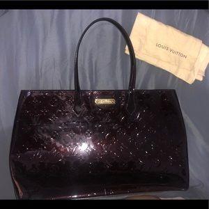 Louis Vuitton bag.